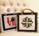 Hand bags stitched at Hingham Square Needlepoint using 6 Ply