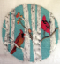 Cardinals in birch trees